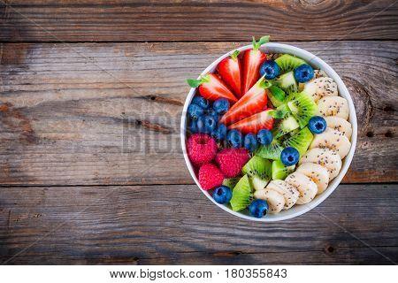 Breakfast Bowl: Granola With Banana, Kiwi, Raspberry, Strawberry, Blueberry And Chia Seeds