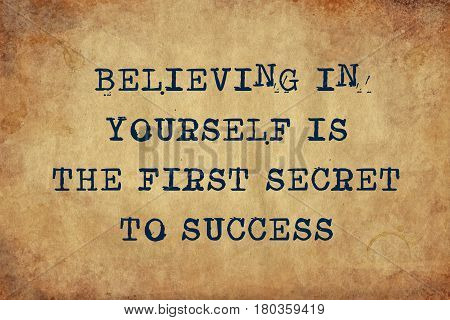 Inspiring motivation quote with typewriter text believing in yourself is the first secret to success. Distressed Old Paper with Typing image.