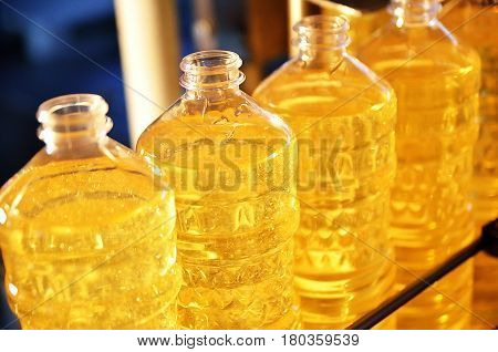Sunflower oil. Factory line of production and filling of refined oil from sunflower seeds. Factory conveyor of food industry