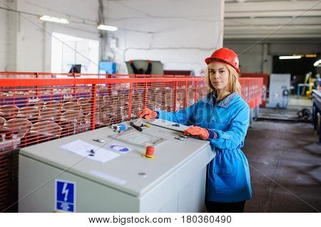 Woman In Red Safety Helmet Work As Industrial Worker