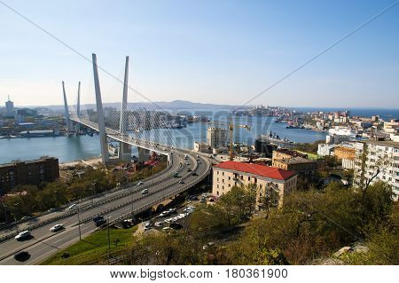 Golden bridge -- cable-stayed bridge across the Zolotoy Rog Bay in Vladivostok. Was built in the framework of preparation to the APEC summit. Modern bridges Russia. The traffic of the port city.