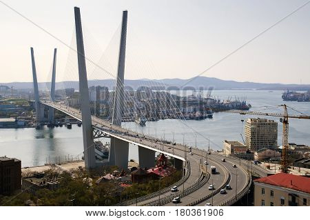 Traffic of the port city. Cable-stayed bridge across the Zolotoy Rog Bay in Vladivostok. Was built in the framework of preparation to the APEC summit. Modern bridges Russia.