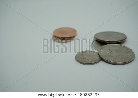 This is a image of different coins on a white background.