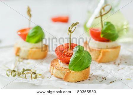 Delicious Crostini With Tomato, Mozzarella And Basil For A Snack