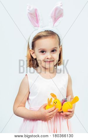 Portrait of a smiling Easter kid holding egg decoration