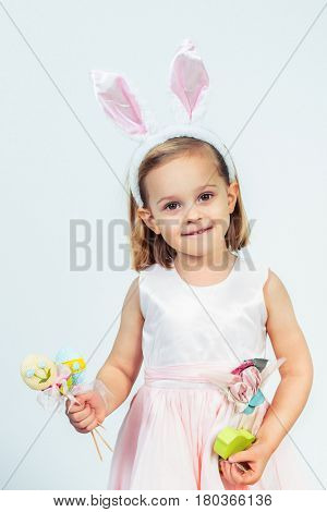 Portrait of a Easter kid holding egg decoration