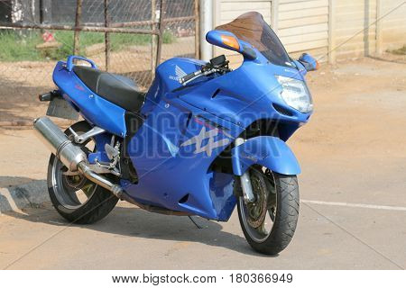Parked Large Blue Honda Motorbike At Yearly Mass Ride