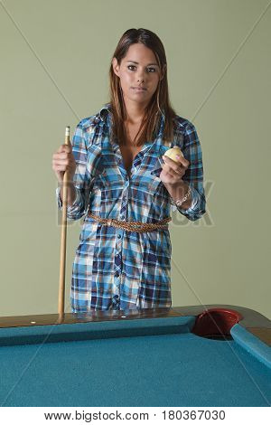 Holding A Cue And A Ball