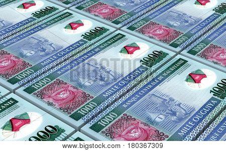 Mauritanian ouguiya bills stacked background. 3D illustration.