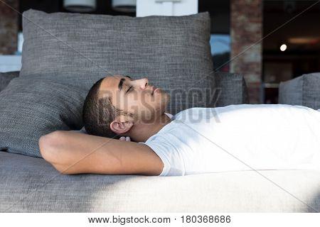 Close-up Of Man Sleeping On Sofa