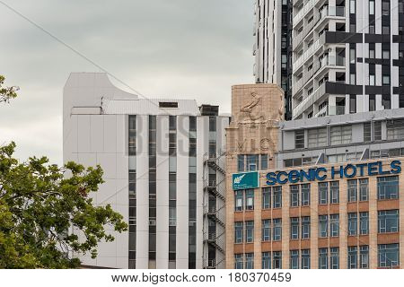 Auckland New Zealand - March 1 2017: Detail of Auckland skyline around Scenic Hotels downtown near Civic Center. Some vegetation and green skies with parts of highrise buildings such as MLC.