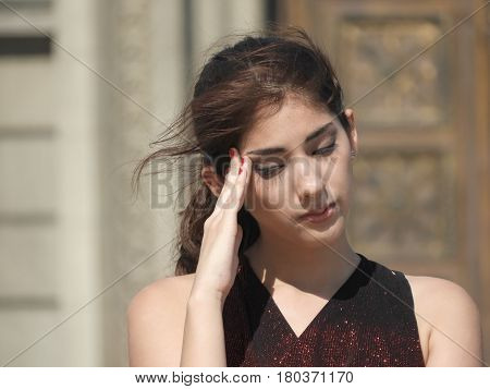 Young Woman With Stress Fever Or Headache