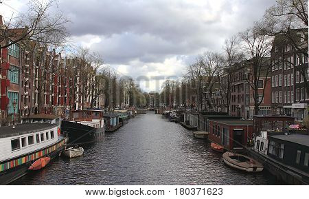 Amsterdam in April 2016. Netherlands. Amsterdam cityscape with houseboats.