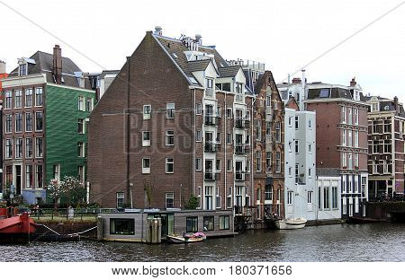 Amsterdam in April, 2016. Netherlands. Amsterdam cityscape with houseboats.