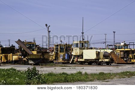 Montreal, Quebec, August 20, 2016 - Wide view of an old railroad bone yard with a variety of work vehicles and parts in the CP Rail Train Yards in Cote Saint Luc in Montreal, Quebec on a sunny day in August.