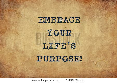 Inspiring motivation quote with typewriter text embrace your life's purpose. Distressed Old Paper with Typing image.