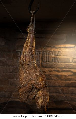 Domestic smoked meat produced in the dark basement