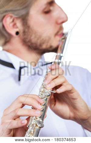 Male Flutist Playing His Flute Closeup