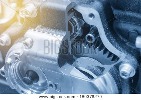 The motorcycle gear box in cross section show in light blue scene with lighting effect