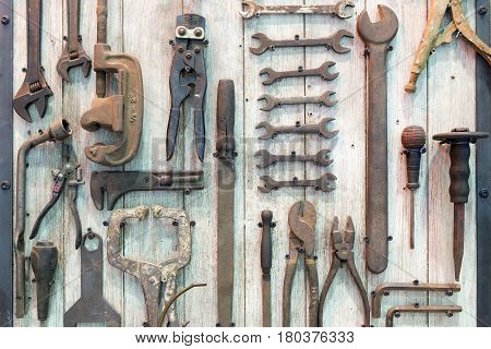 The various type of tool in tool room.The old tool in tool room hanging at the board