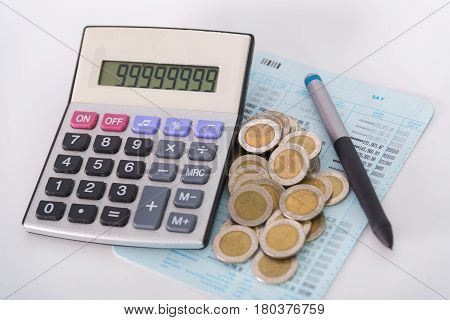 Increasing Columns Of Coins, Piles Of Coins Arranged As A Graph And Calculator With Pen On White Bac