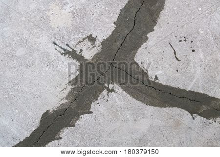 seal of cracks on a concrete floor.Image of the flying bird