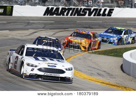 April 02, 2017 - Martinsville, Virginia, USA: Brad Keselowski (2) leads a pack of cars during the STP 500 at Martinsville Speedway in Martinsville, Virginia.