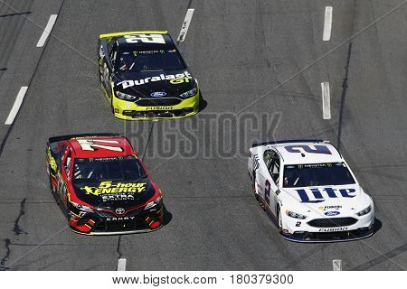 April 02, 2017 - Martinsville, Virginia, USA: Brad Keselowski (2), Erik Jones (77) and Joey Logano (22) battle for position during the STP 500 at Martinsville Speedway in Martinsville, Virginia.