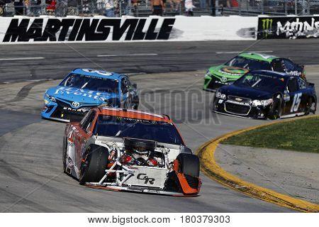April 02, 2017 - Martinsville, Virginia, USA: Daniel Suarez (19) races his damaged car during the STP 500 at Martinsville Speedway in Martinsville, Virginia.