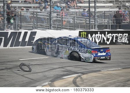 April 02, 2017 - Martinsville, Virginia, USA:  Jamie McMurray (1) wrecks during the STP 500 race at the Martinsville Speedway in Martinsville, Virginia.