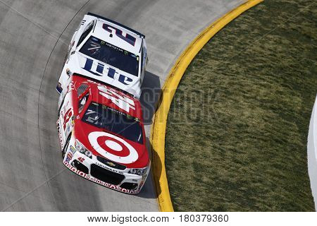 April 02, 2017 - Martinsville, Virginia, USA: Kyle Larson (42) and Brad Keselowski (2) battle for position during the STP 500 at Martinsville Speedway in Martinsville, Virginia.