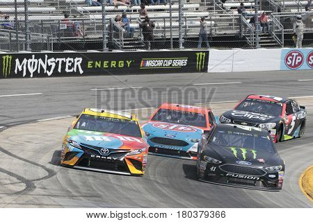 April 02, 2017 - Martinsville, Virginia, USA:  Kurt Busch (41), Kyle Busch (18) bring their race cars through the turns during the STP 500 race at the Martinsville Speedway in Martinsville, Virginia.
