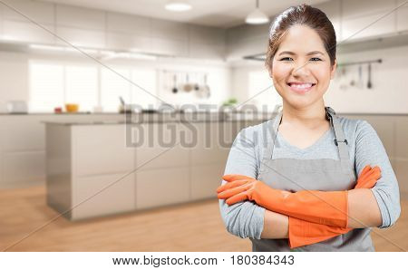 asian housewife wearing rubber gloves with kitchen background