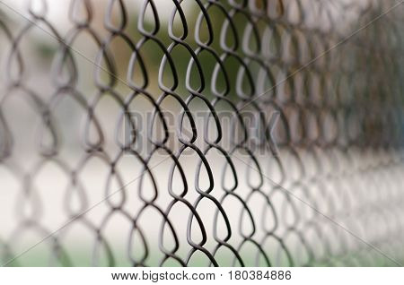chain link fence with blurred background and foreground