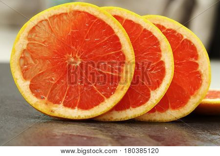 Grapefruit pulp / The grapefruit is a subtropical citrus tree known for its sour to semi-sweet fruit.