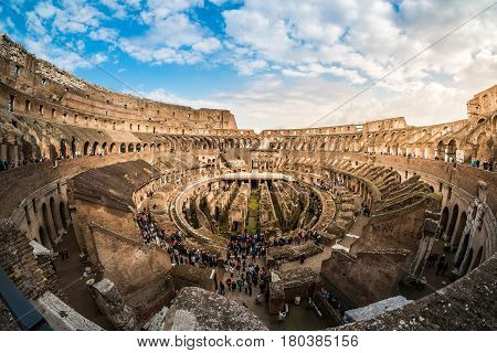 ROME, ITALY - MARCH 23, 2015: Tourist visiting inside the Colosseum, the famous Roman monument in Rome, Italy, on a sunny day.