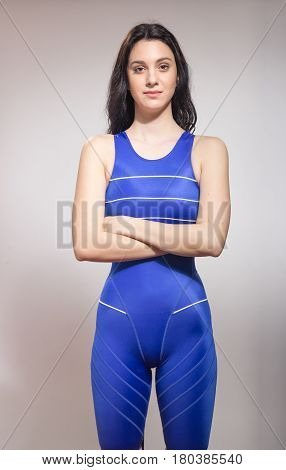 One Young Woman Swimmer, Arms Crossed