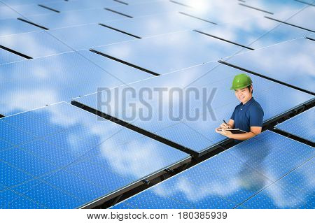solar panel technician with blue solar panel station