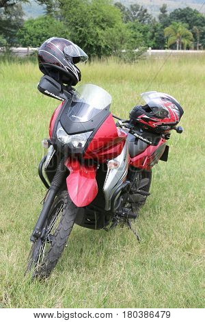 Parked Red Kawasaki Motorbike On Green Grass