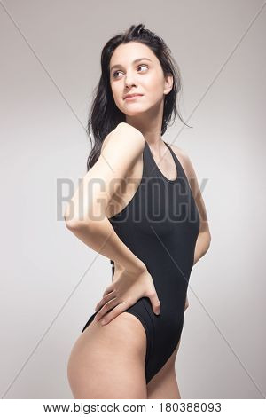 One Young Woman, Standing Swimmer Swimsuit, Looking Sideways Glance