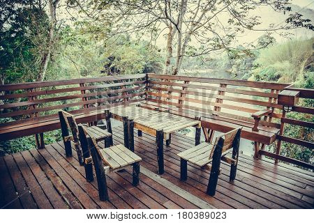 Wooden Table And Chair In Resort And Garden, Dining Set At Wooden Terrace In Restaurant. Vintage Ton