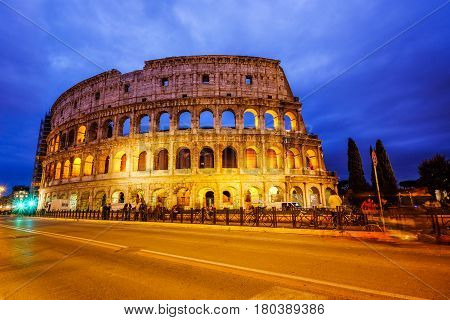 Colosseum, the famous Roman monument in Rome, Italy, in twilight time