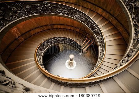 VATICAN - MARCH 24, 2015 : Tourist visiting the Spiral Staircase, the famous staircase in the Vatican Museum in Rome, Italy