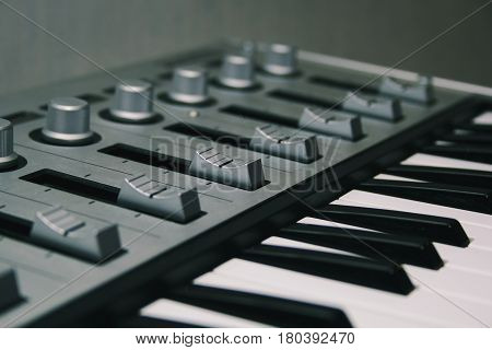 Midi keyboard close up keys and faders