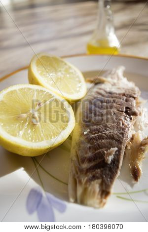 steamed sea bream fillet seasoned with olive oil and lemon