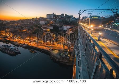 View from Dom Luis I bridge, Douro river and Ribeira at night in historical center of Porto, Portugal.