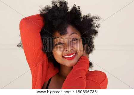 Attractive Young Woman Smiling With Hand In Hair