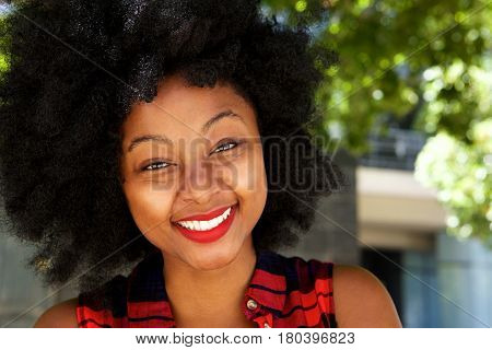 Beautiful Young African Woman Smiling Outside By Tree