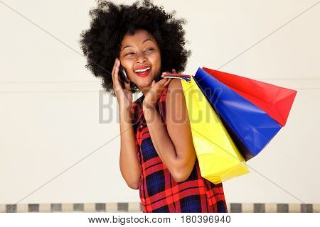 Happy Beautiful Woman Talking On Phone With Bags