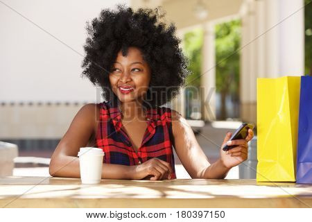 Happy Woman With Cellphone And Coffee At Cafe